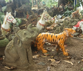 Pile of model animals decorating a shrine
