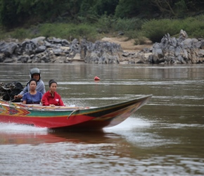 High speed boat passes us on the Mekong