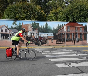 Cycling past Chemainus Mural