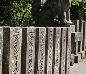 Carved stone pillars at Shinto Temple