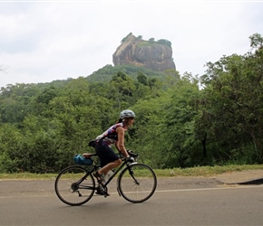 Christine Ratcliffe cycles past Sigiriya Rock Fortress