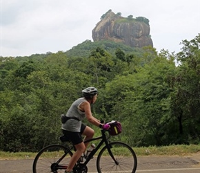 Janet Ellis cycles past Sigiriya Rock Fortress