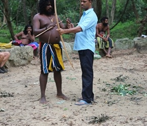 Narmal shooting arrows at the Veddah Village