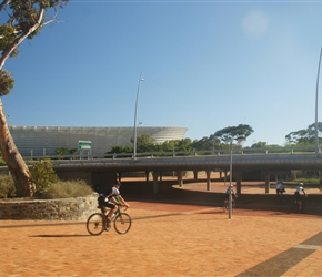 Bruce Whiteside passes the newly completed football stadium for the world cup in Cape Town