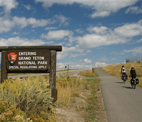 Diane enters Grand Teton along the cycle path