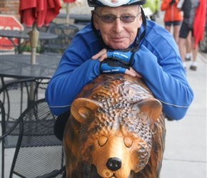 Phil and carved wooden bear