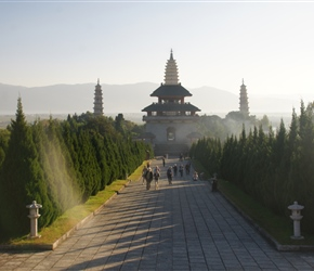 Walking away from the 3 pagodas and temple