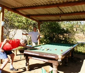 Snooker is popular in China, and this one was by the roadside, so Emrys thought we'd have a game of pool