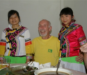 Frank with our waitresses at Ju Hua Inn