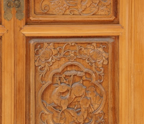 Beautifuly carved wooden door at Xiangyun