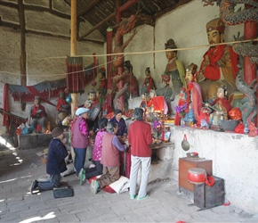 Ladies worshipping at the roadside temple