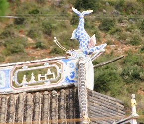 Fish decoration atop roof