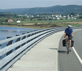 Paul crosses the bridge at Margaree