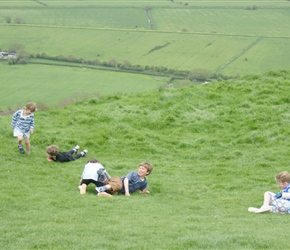 Kate, Edward, James Louise and Lucy rolling down Glastonbury Tor