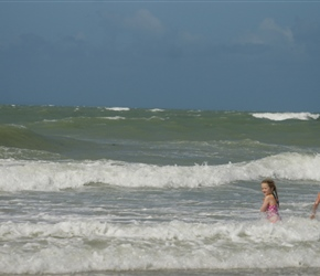 Louise and Kate enjoy the surf at Pirou Plage