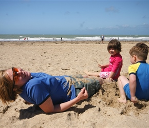 Gabriella and Jacob burying their mum at Pirou Plage