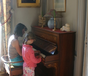 Jo and Kate test out the piano at the chateau