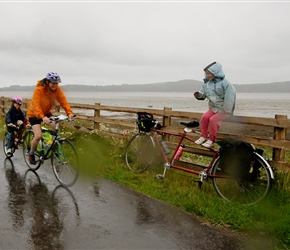 Louise encourages Clare and Morven that it wasn't her idea but her fathers to cycle in the rain