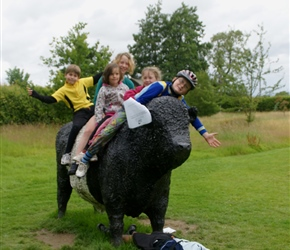 Christopher, Morgan, Ariane, James, Louise and Matthew on a Galloway cow at Threave