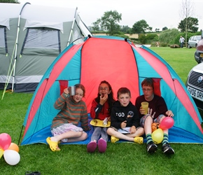 Louise, Lucy, Finlay and James enjoy the BBQ in the play tent