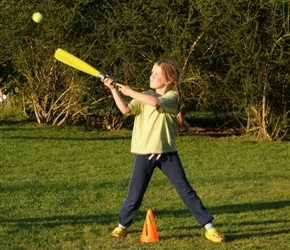 Louise hits the ball at the annual rounders game