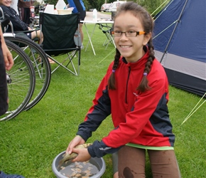 Lucy with a small carp at the campsite. I have no idea where it cane from