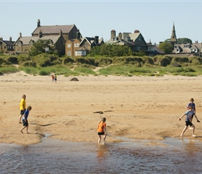 The boys test the water at Alnmouth