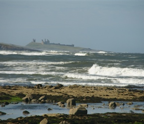Beach and Dunstanburgh Castle from the off road section of Sustrans route 1