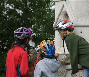 Lucy, Louise and Catherine gather around the Chillingham Memorial