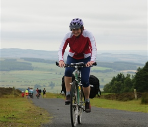 Clare arrives at the top of the Ros Castle climb