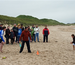 Andy takes strike at the Rounders match on Dunstanburgh Beach