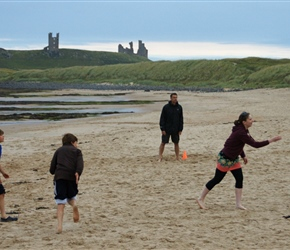 Sarah pitches whilst the Turnpenny's and Dunstanburgh Castle look on