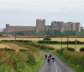 Andy and Jenny descend towards Bamburgh Castle