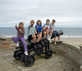 Louise, Bill, Christopher, James and Matthew on a cannon at Bamburgh Castle