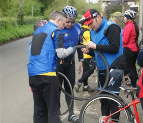 One of the many lovely things about these holidays was that if something went wrong, others pitched in. In this case Nigel, Steve and Kevin look to repair a puncture