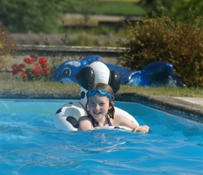 Abbie takes a dip. Lots of inflatables in this pool