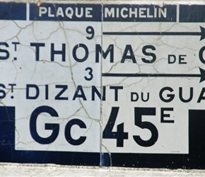 Michelin produced lots of enameled road signs. You don't see many, but they are pretty striking