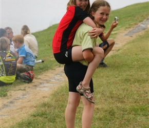 Louise piggybacks Abbie at lunch