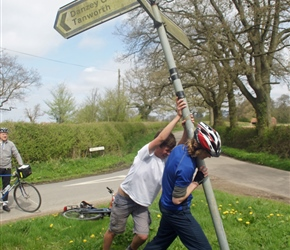So the sign was falling over. Being a proud cycling citizen, Ed thought he'd try to rectify this
