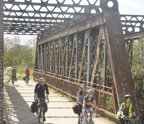 The Evans family crosses the old railway bridge on the Stratford Cycleway