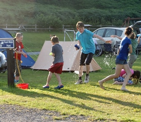 Water fight at the campsite