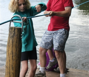 Neil helps Freya pull the raft across the lake at the Otter Centre