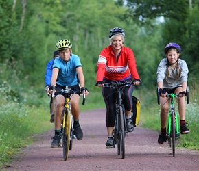 Oscar, Vanessa and Ellie Carter on cycle path to Coutances