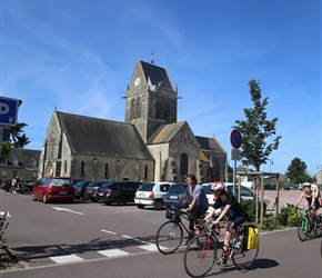 Sainte Mere Eglise. Paratroopers rained down on this Norman village as D-Day operations began in June 1944 to liberate Europe from German occupation. Famously, American soldier John Steele was left dangling a time from the medieval church