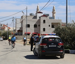 Martyn greets our police escort in Kerak. We had 4 officers that day