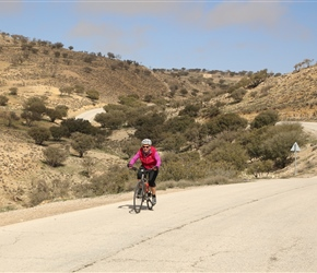 Having taken the short climb from the Kings Highway past the Oak Trees, Mel starts the descent