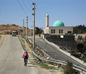 Mel heads past a mosque