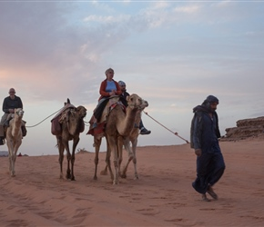 Mel and Tim go on a camel ride