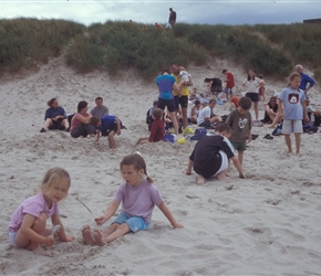 Louise and Ariane playing in the sand at Bamburgh Beach