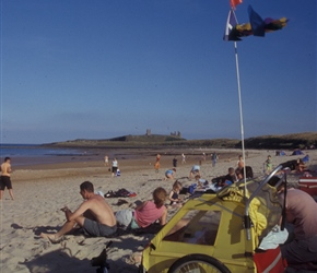 Trailer et al on the beach with Dunstanburgh Castle in the background